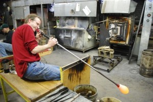 Artist creates custom glass item in Hot Glass Studio